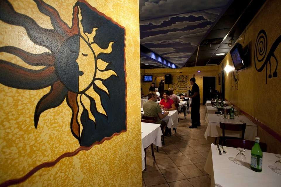 Colorful artwork decorates the walls of the dining
