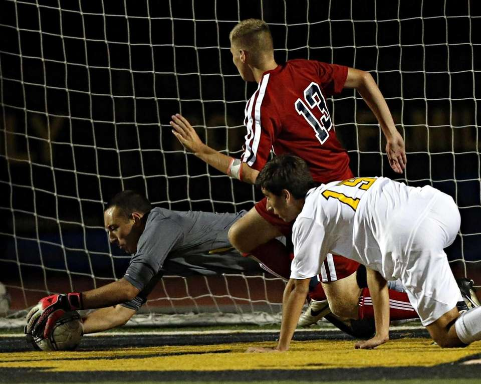 St. Anthony's keeper Josh Weiss covers up the