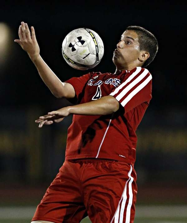St. John the Baptist's Michael Martinez controls the