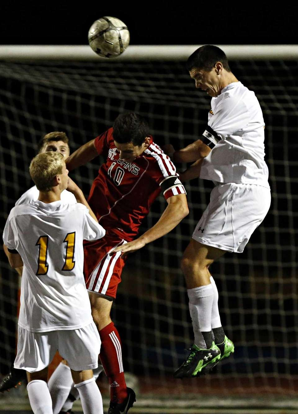 St. Anthony's Nick Cestaro heads the ball of