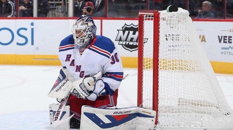 Goaltender Henrik Lundqvist of the Rangers makes save