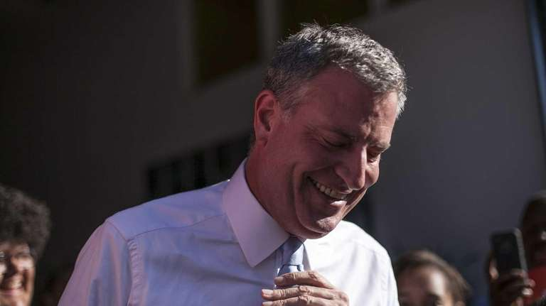 Mayoral candidate Bill de Blasio campaigns at the