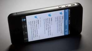 Twitter Inc. tweets show on a mobile device