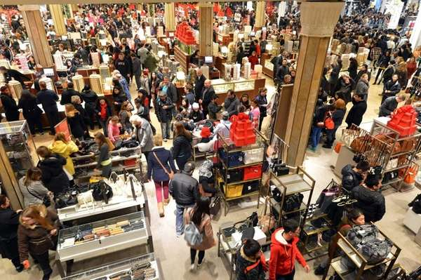 People crowd the first floor of Macy's department
