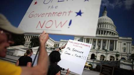 Furloughed federal workers chant and shout as House