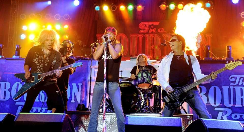 Poison, with singer Bret Michaels and musicians C.C.