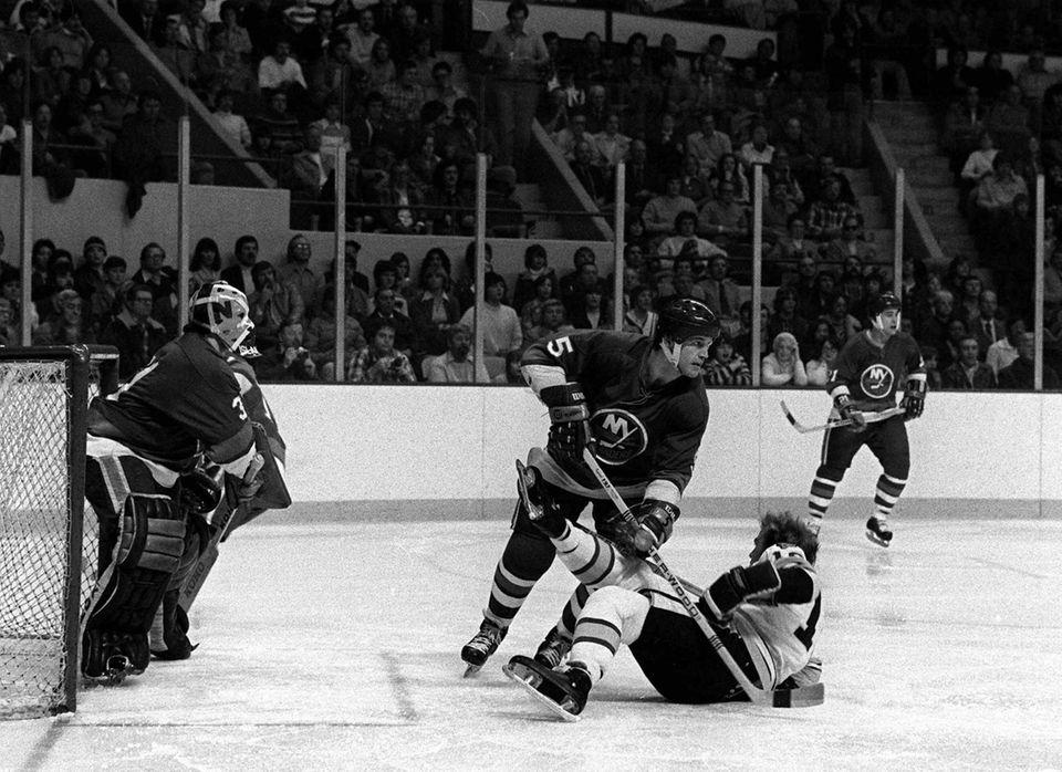 Denis Potvin sends Boston Bruins Rick Middleton to