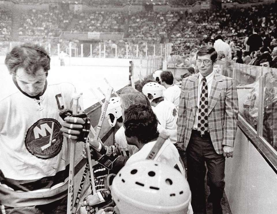 Islanders coach Al Arbour paces behind the bench