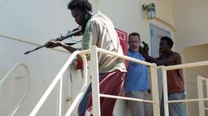 Tom Hanks, left, and Barkhad Abdi star in