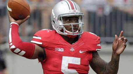 Ohio State quarterback Braxton Miller throws a pass