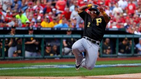Marlon Byrd of the Pittsburgh Pirates slides home