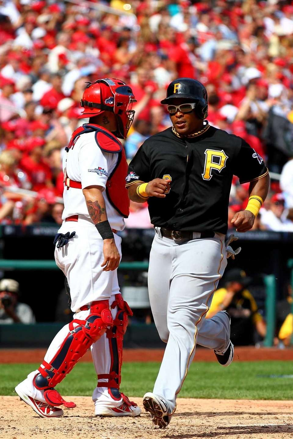 Marlon Byrd of the Pittsburgh Pirates scores a
