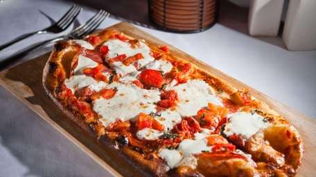 The diavolo flatbread is topped with fennel salami,