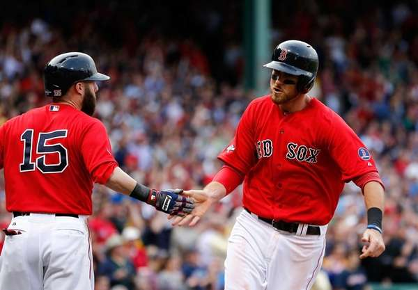 Will Middlebrooks celebrates a run with Dustin Pedroia