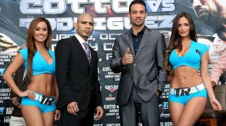 Delvin Rodriguez, left, and Miguel Cotto pose during