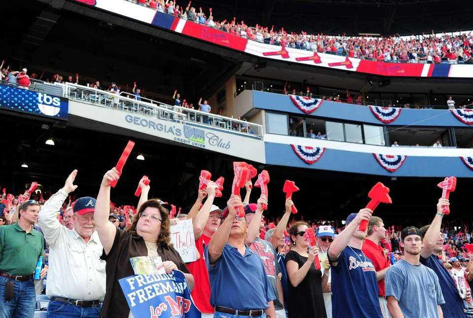 Fans of the Atlanta Braves cheer at Turner