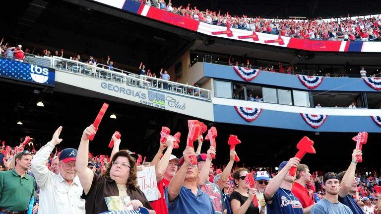 Fans of the Atlanta Braves cheer at Turner