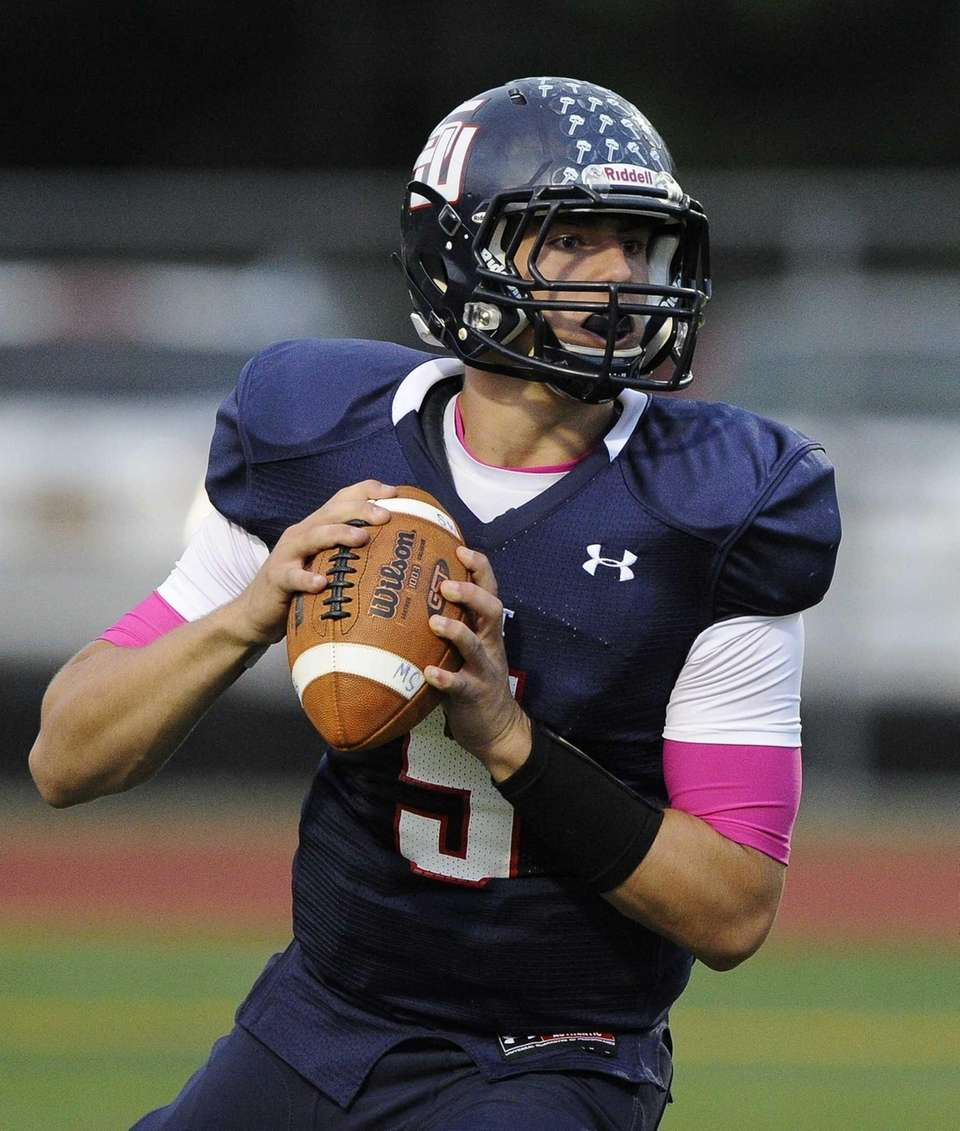 Smithtown West quarterback Matthew K. Heldberg Jr. drops