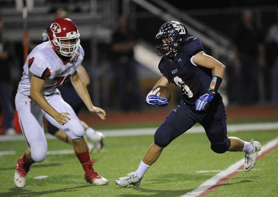Smithtown West's Ryan J. Keenan carries the football
