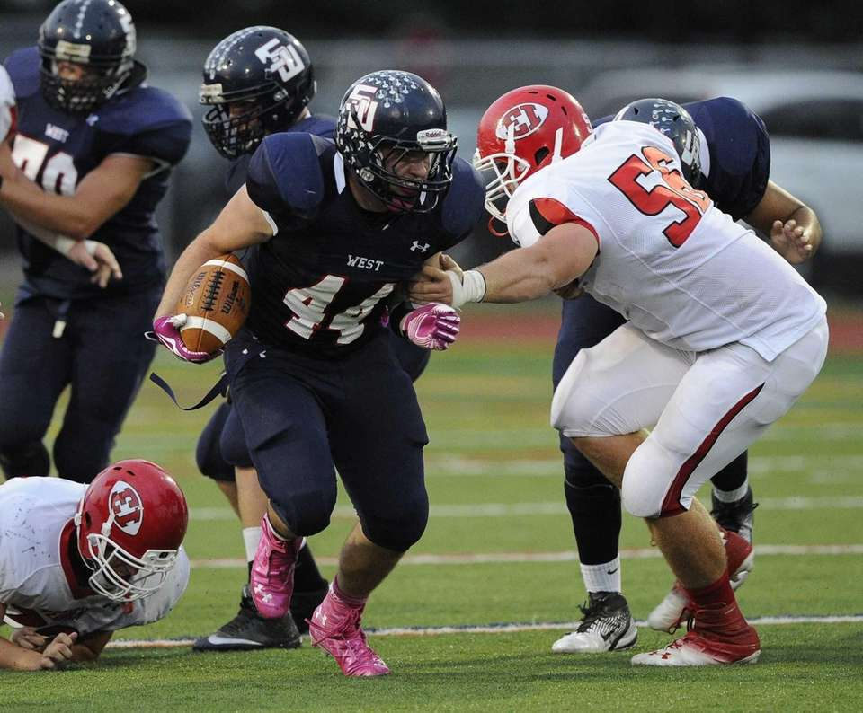 Smithtown West's Logan W. Greco escapes a tackle