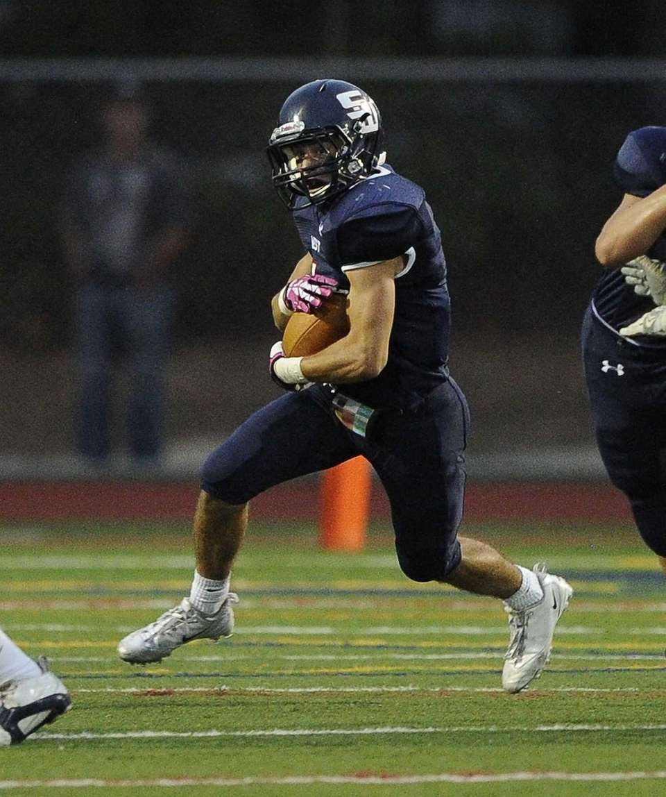 Smithtown West's Andrew J. Lapreziosa carries the football