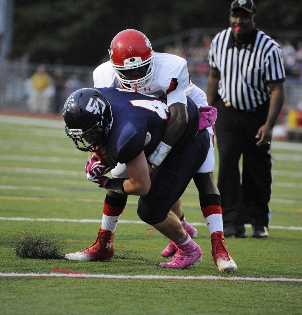 Smithtown West's Logan W. Greco rushes the football