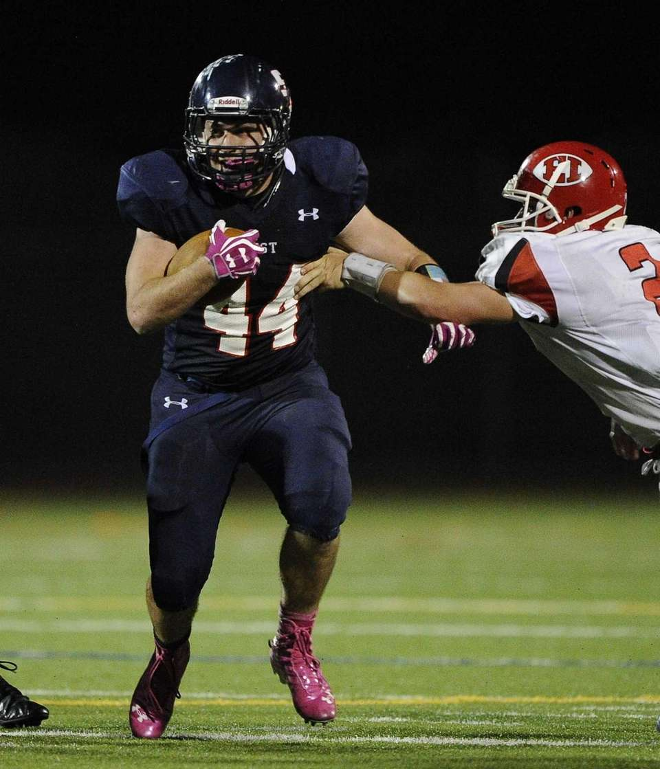 Smithtown West's Logan W. Greco runs the football