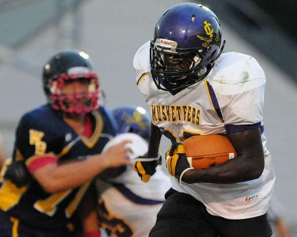 Central Islip's Kevin Mowatt runs for a gain