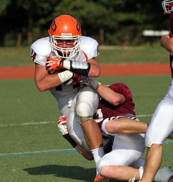 Carey's Andrew Ris keeps both hands on ball