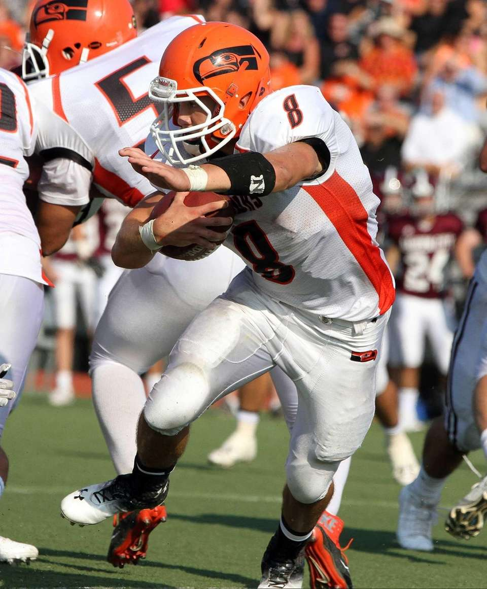 Carey's Mike DeLeo looks for open field against