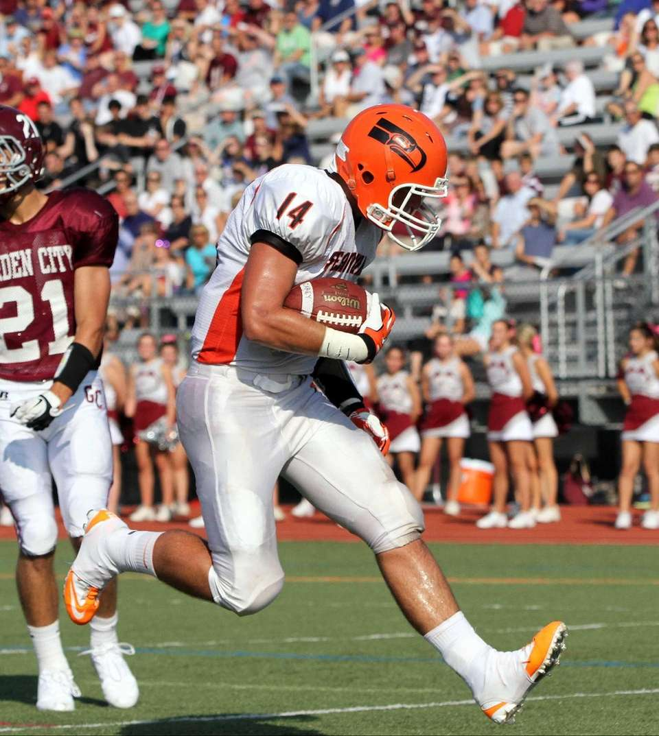 Carey's Andrew Ris scores the first TD of