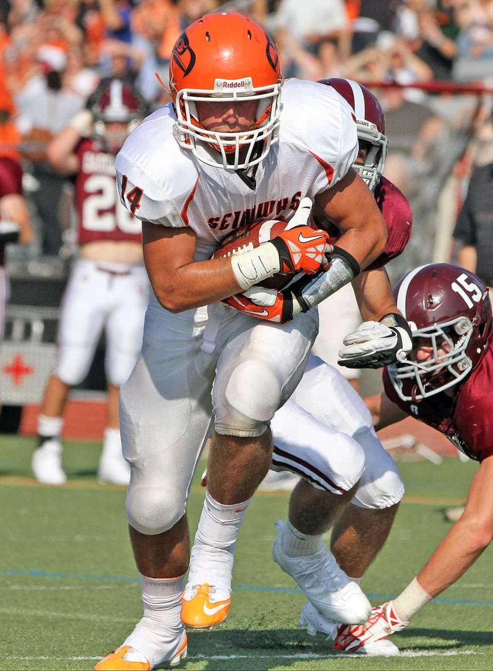 Carey's Andrew Ris races toward the end zone