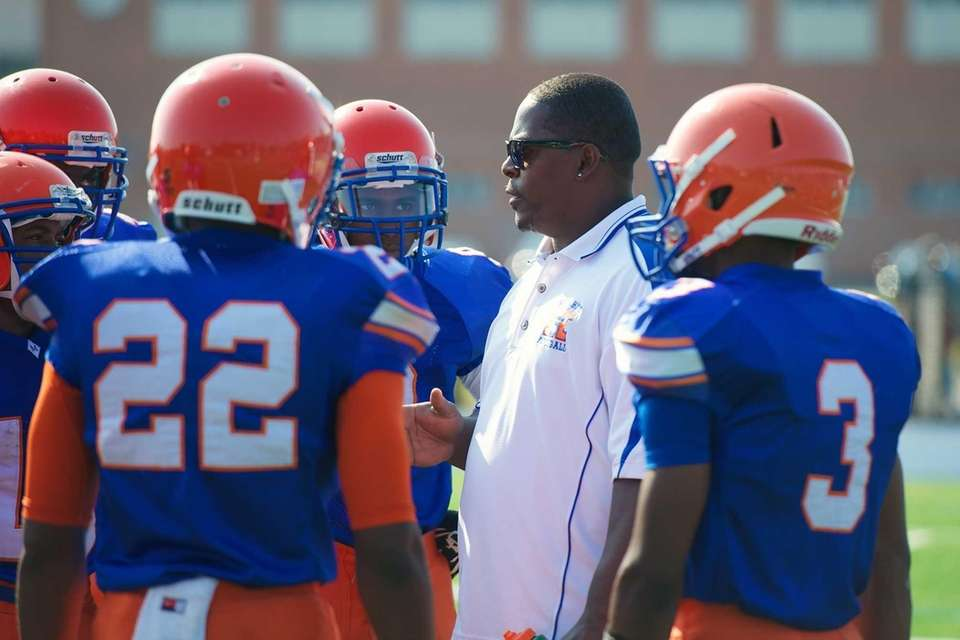 Malverne head coach Kito Lockwood talks with his