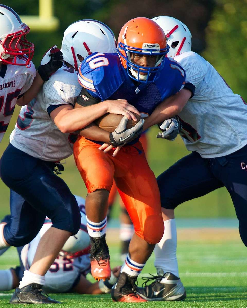 Malverne receiver James Choisi (no. 10) pushes forward