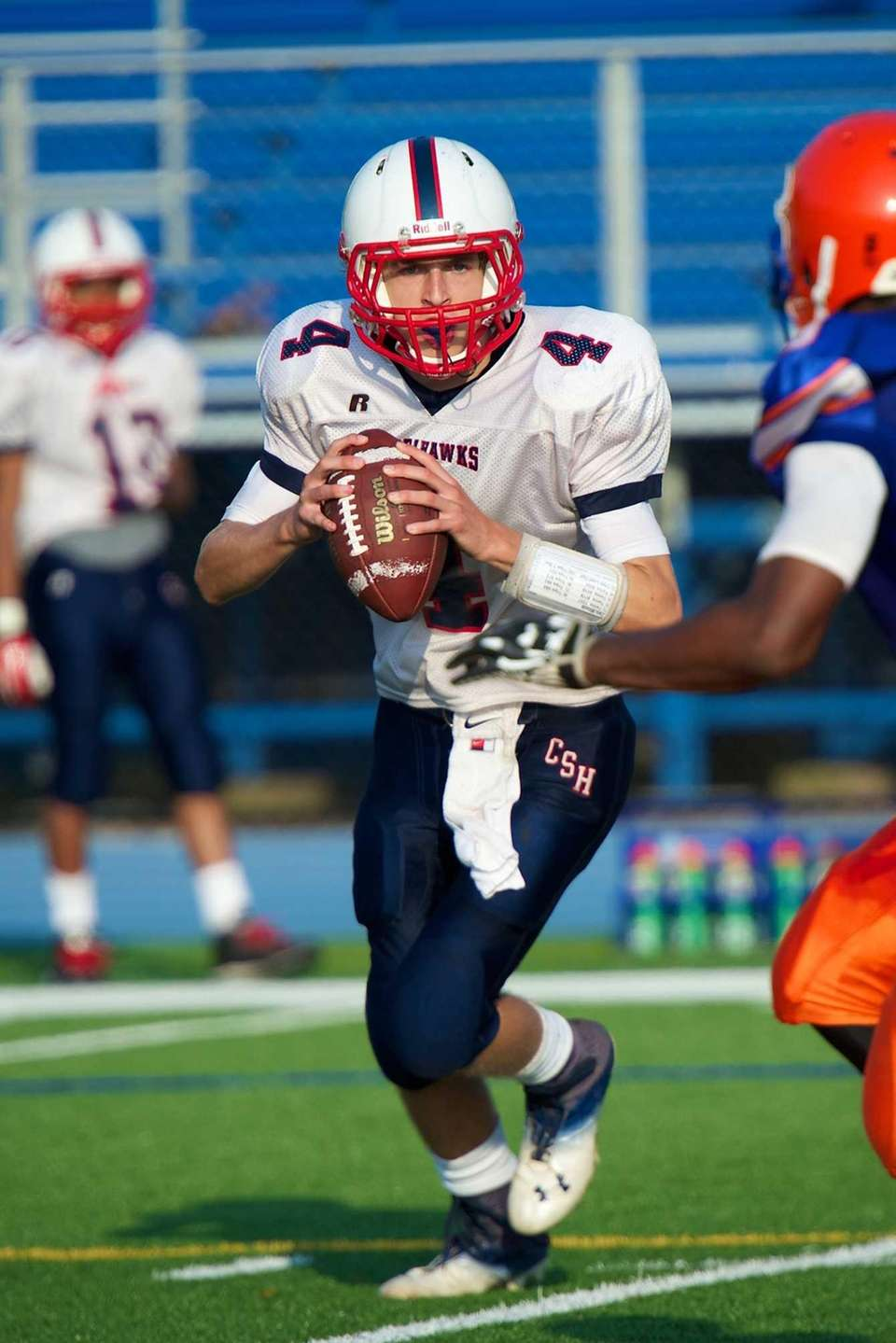 Cold Spring Harbor quarterback Wes Szajna rolls out