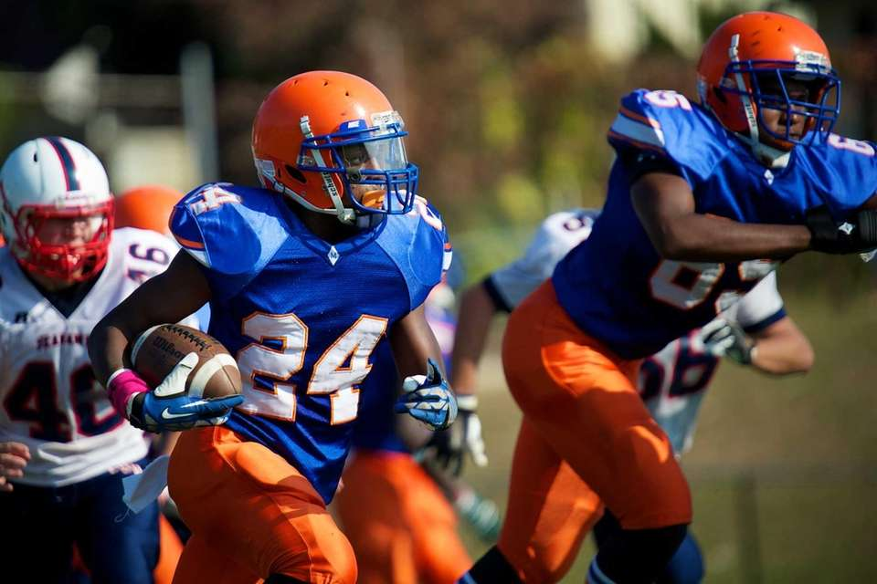 Malverne running back Christopher Hackett (no. 24) runs