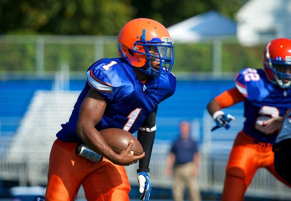Malverne quarterback Jamal Aaron Hill (no. 1) runs