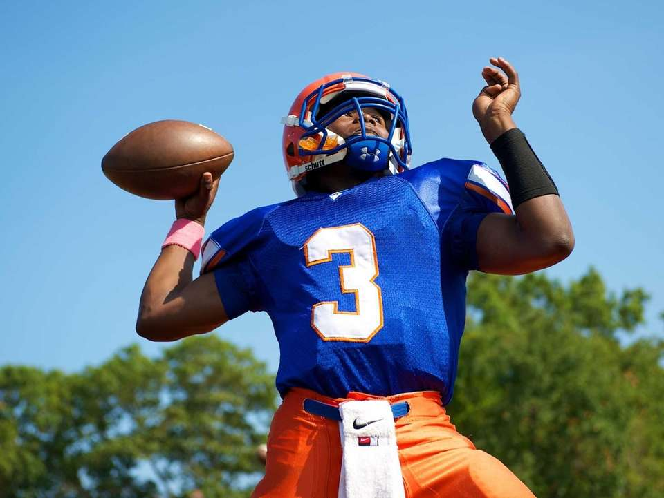 Malverne quarterback Byrce Todd warms up prior to