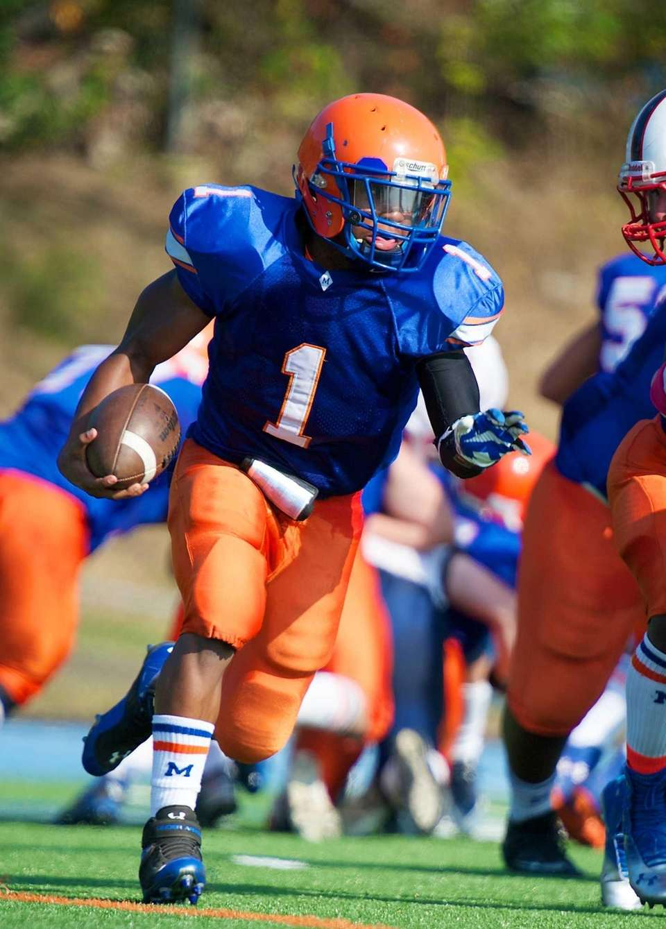Malverne quarterback Aaron Hill (no. 1) sprints for