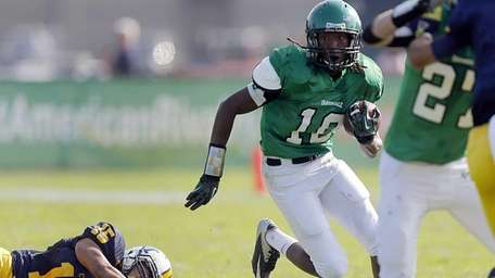 Farmingdale running back Curtis Jenkins rushes against the