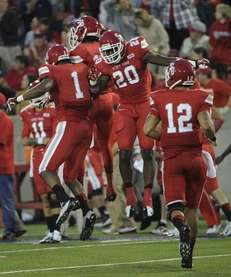 Stony Brook wide receiver Adrian Coxson, left, celebrates