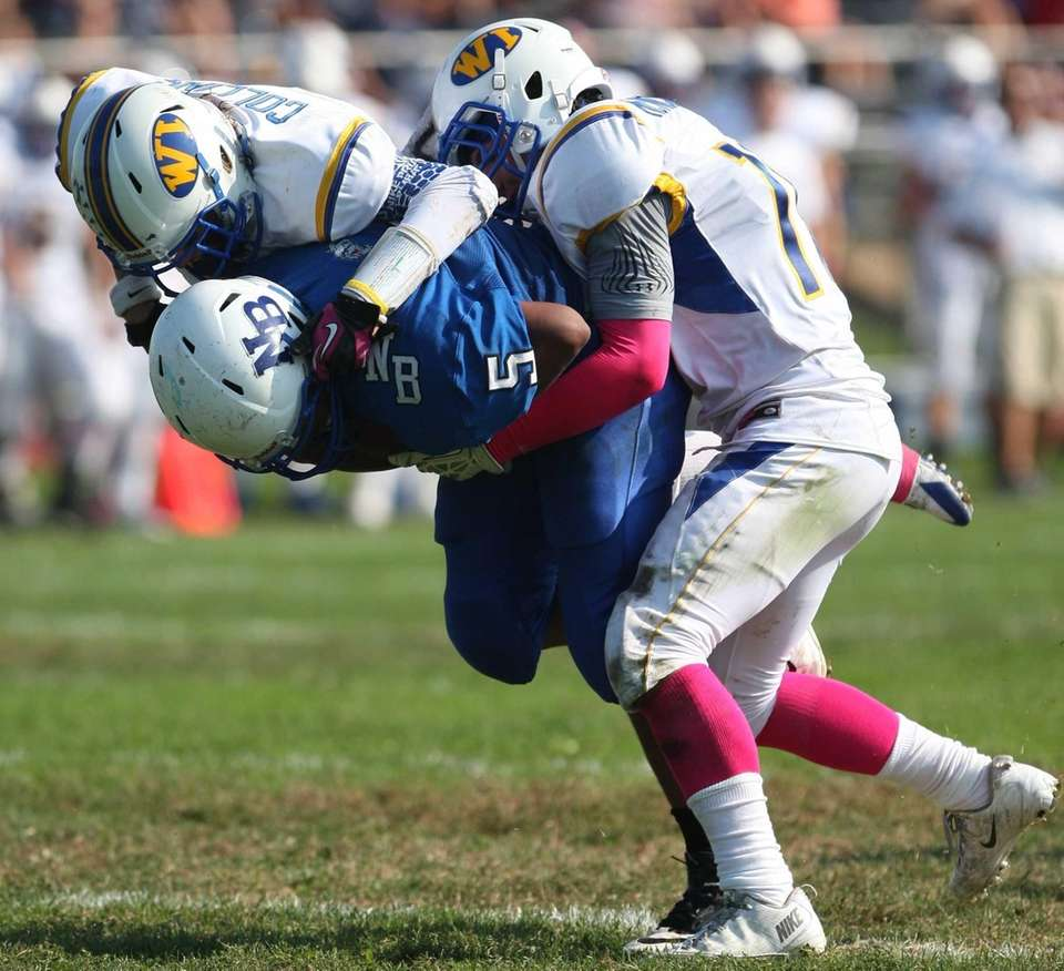 North Babylon's Brandon Sobotker (no. 5) gets brought