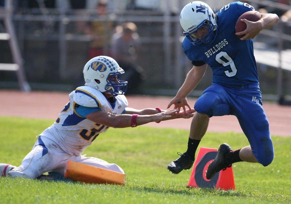 North Babylon quarterback Kevin Conner (no. 9) gets