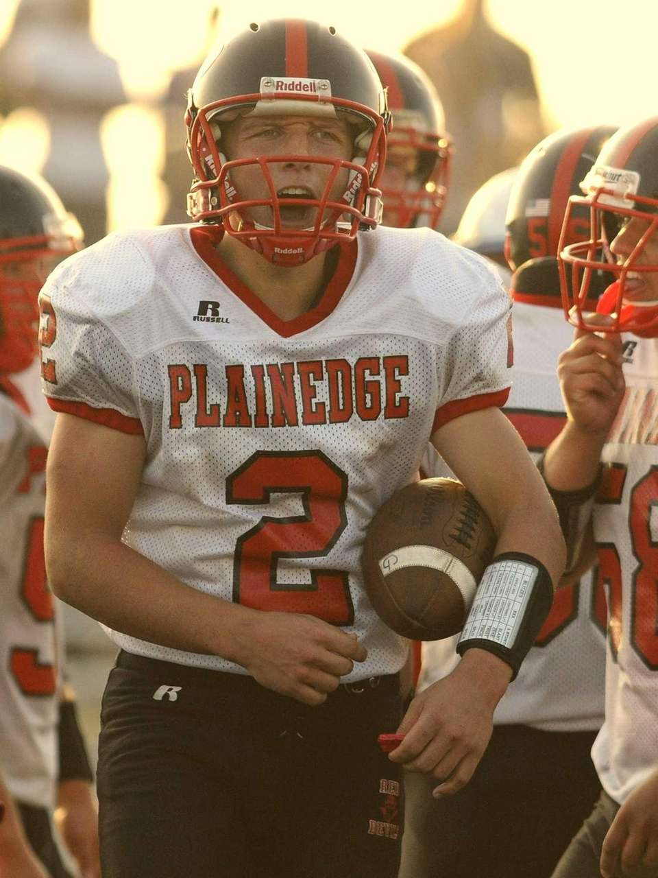 Plainedge quarterback Nick Frenger reacts as he leads