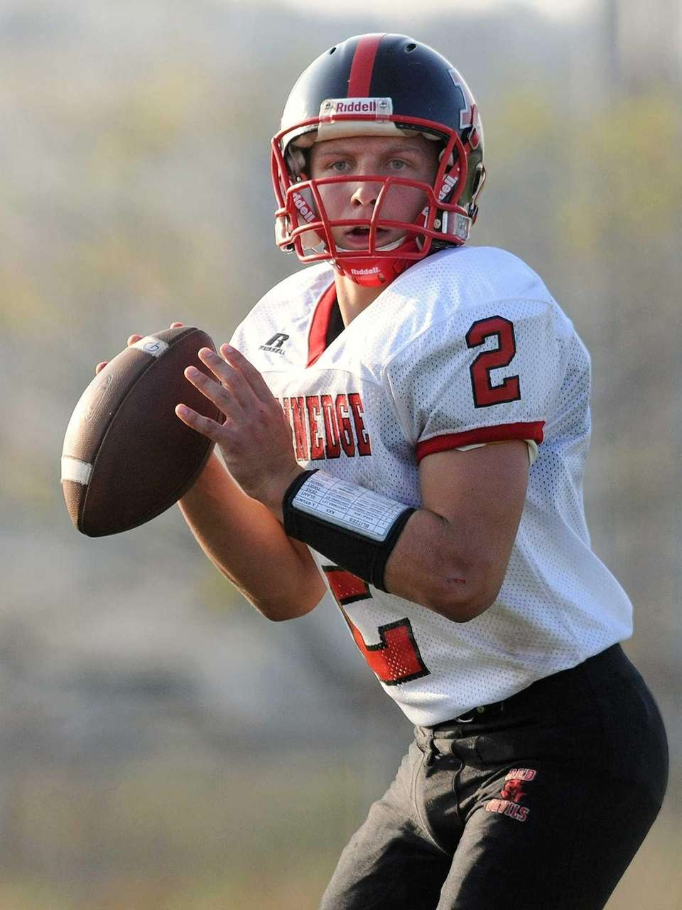 Plainedge quarterback Nick Frenger looks for an open