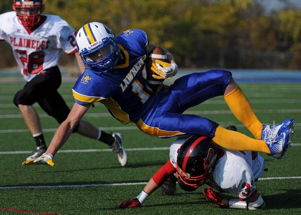 Lawrence wide receiver Sean Moran gets upended after