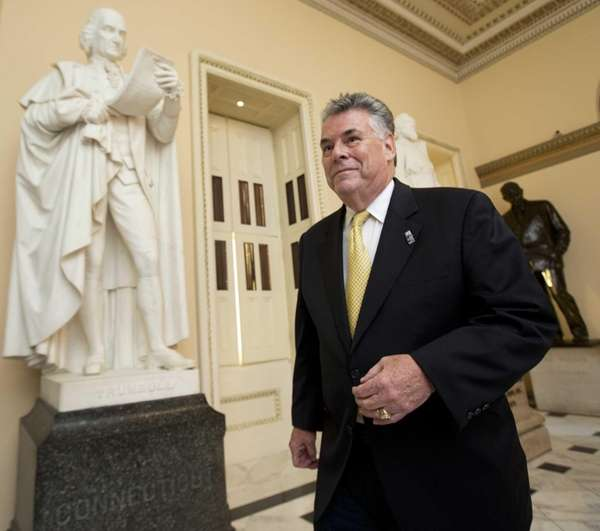 Rep. Peter King walks towards the House Chamber