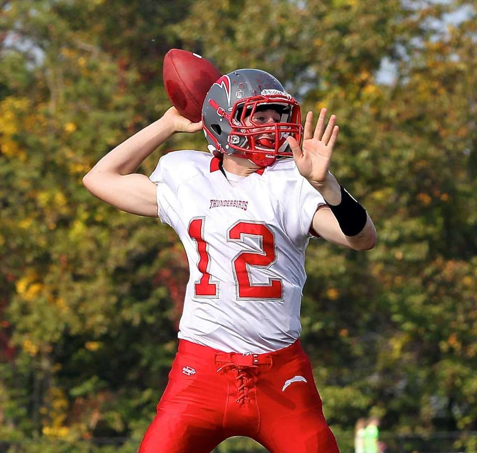 Connetquot quarterback Ricky Hahn looks to pass during