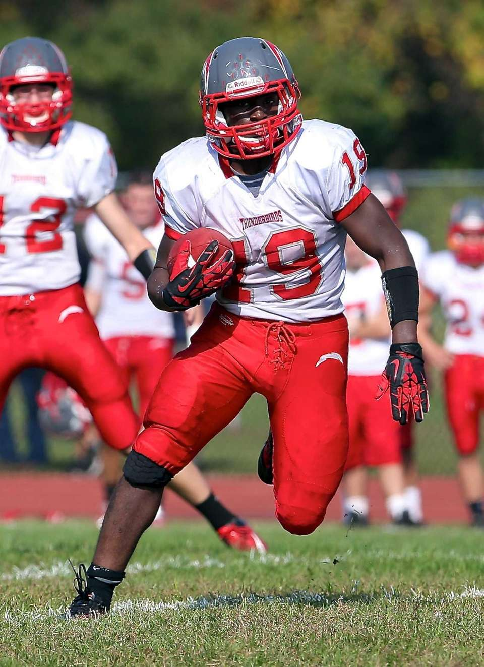 Connetquot running back Marcus Gutierrez (no. 19) rushes