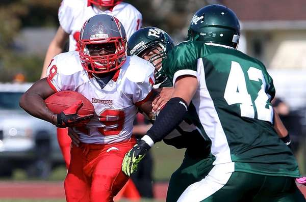 Connetquot running back Marcus Gutierrez looks to get